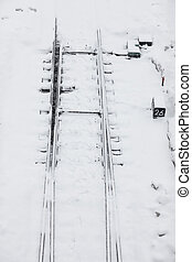 Railroad tracks in the snow in winter