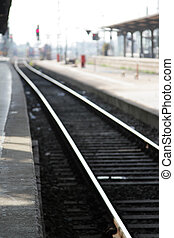 Railroad tracks in the station, focus on foreground.
