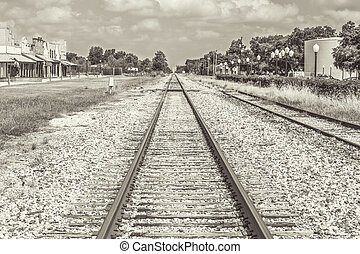 A rural scene of railroad tracks set with a sephia tone.