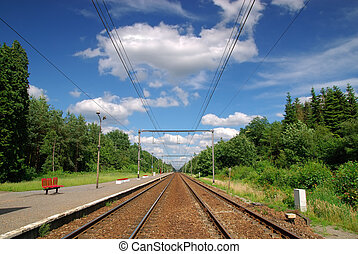 Railroad tracks with powerlines seemingly disappearing into...