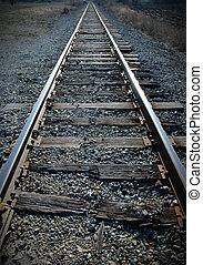 Railroad Tracks - Old railroad tracks with broken grungy...