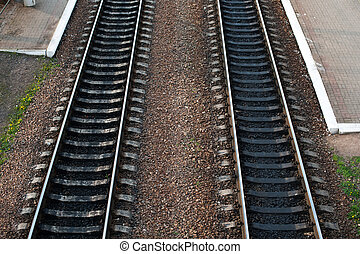 railroad tracks with railroad switch two paths come...