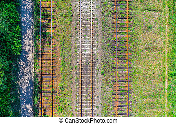 Railroad tracks with wooden sleepers and concrete, aerial view.