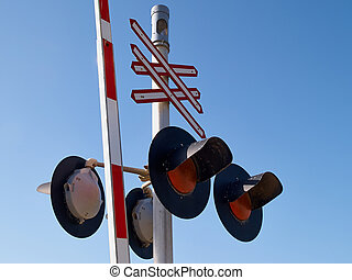 Railroad train crossing sign signal light with clear blue...