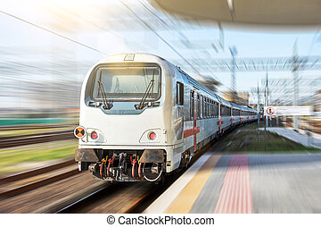Railroad travel. High speed train with motion blur effect.