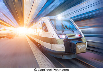 Railroad travel passenger train with motion blur effect, industrial a district of the city
