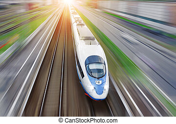 Railroad travel passenger train with motion blur effect, industrial a district of the city, top aerial view from above.