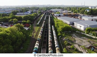 Railroad with train of barrels oilcar stored on rails