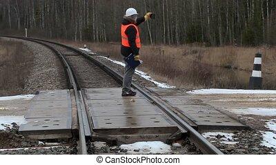 Railroad worker take picture on railway crossing