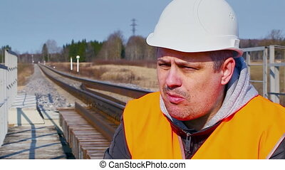 Railroad worker with canned meat