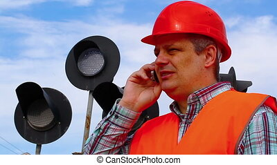Railroad worker with cell phone