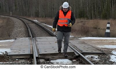 Railroad worker with documentation and adjustable wrench...