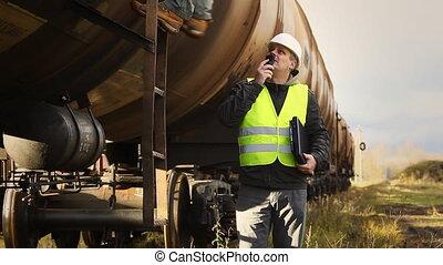 Railroad workers - Railroad worker near the tank wagons...