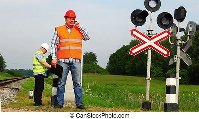 Railroad workers with folders 2