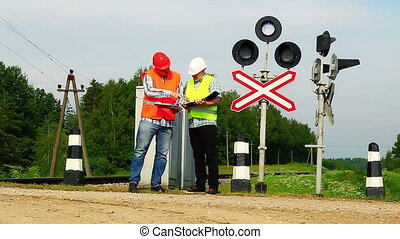 Railroad workers with folders 3