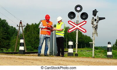 Railroad workers with folders 4