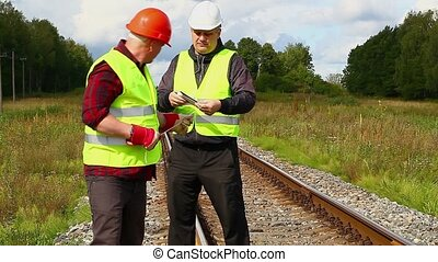 Railroad workers with rope
