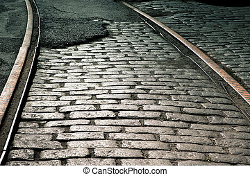 Rails and cobblestones - Old train rails on cobblestone ...