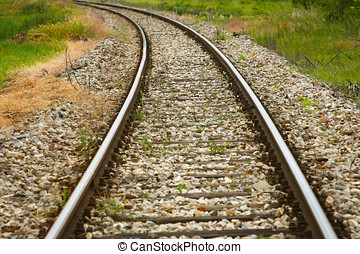Rails in countryside - A view of the train rails in the...