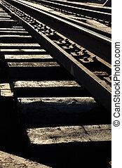 Rails on bridge in sunset time.
