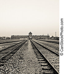 Rails to Auschwitz - Entrance gate building and rails in to...