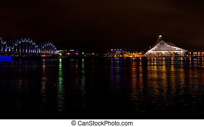 Railway bridge and buildings in Riga at night