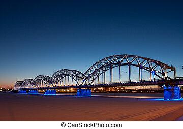 Railway bridge at night in winter close up
