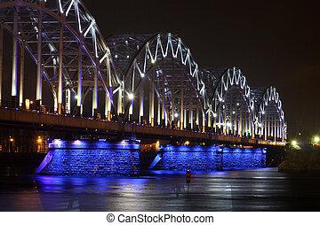 Railway bridge at night with white-blue illumination