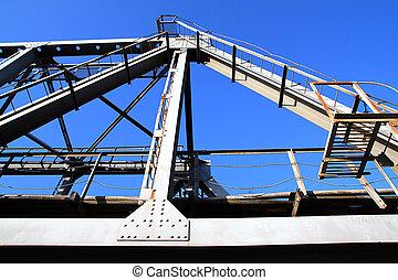 railway bridge on background blue sky
