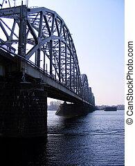 Railway bridge over the beautiful river Daugava in Riga,...