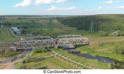Railway bridge river cars road aerial drone view forward push in tilt down camera movement