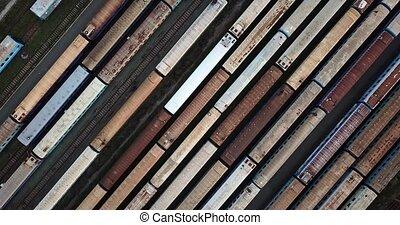Railway carriages on rail tracks - Multicolored railway...
