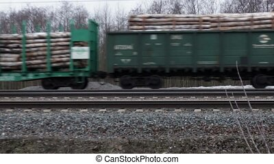 Railway carriages with roundwood
