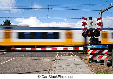 Railway crossing - High speed train passing a railway...