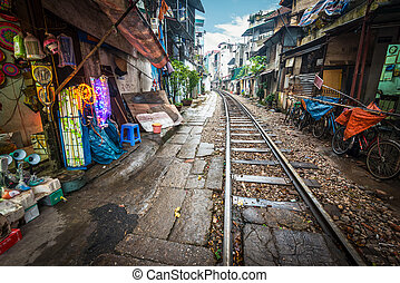 Railway crossing the street in city, Vietnam. - Perspective...