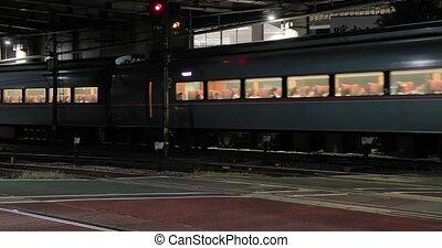 Railway crossing train going through in an urban area