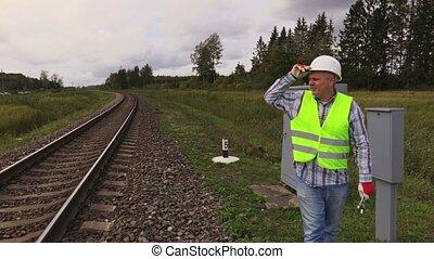 Railway electrician on rails