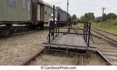 Railway employee check the depot territory