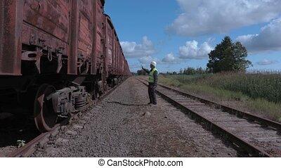 Railway employee numbering wagons