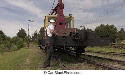 Railway employee walk along the train