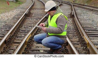 Railway engineer looking