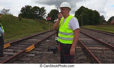 Railway Engineer talking on walkie talkie