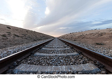 railway in desert terrain summer day