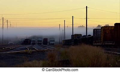 Railway in fog. Rails stretching out into the fog.