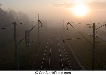 Railway in the foggy morning