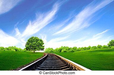 railway in the green field - Tree in the green field near...