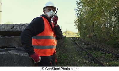 Railway inspector in the air mask at railway