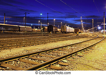 Railway lines at night.