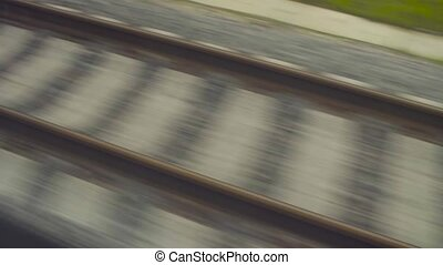 Railway rails shooting from a moving train. Moving train...