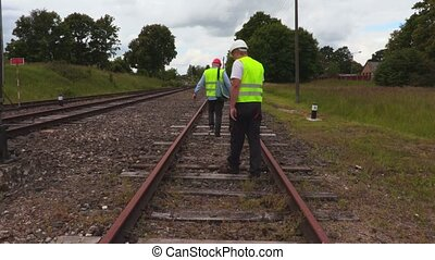 Railway staff checks railway condition